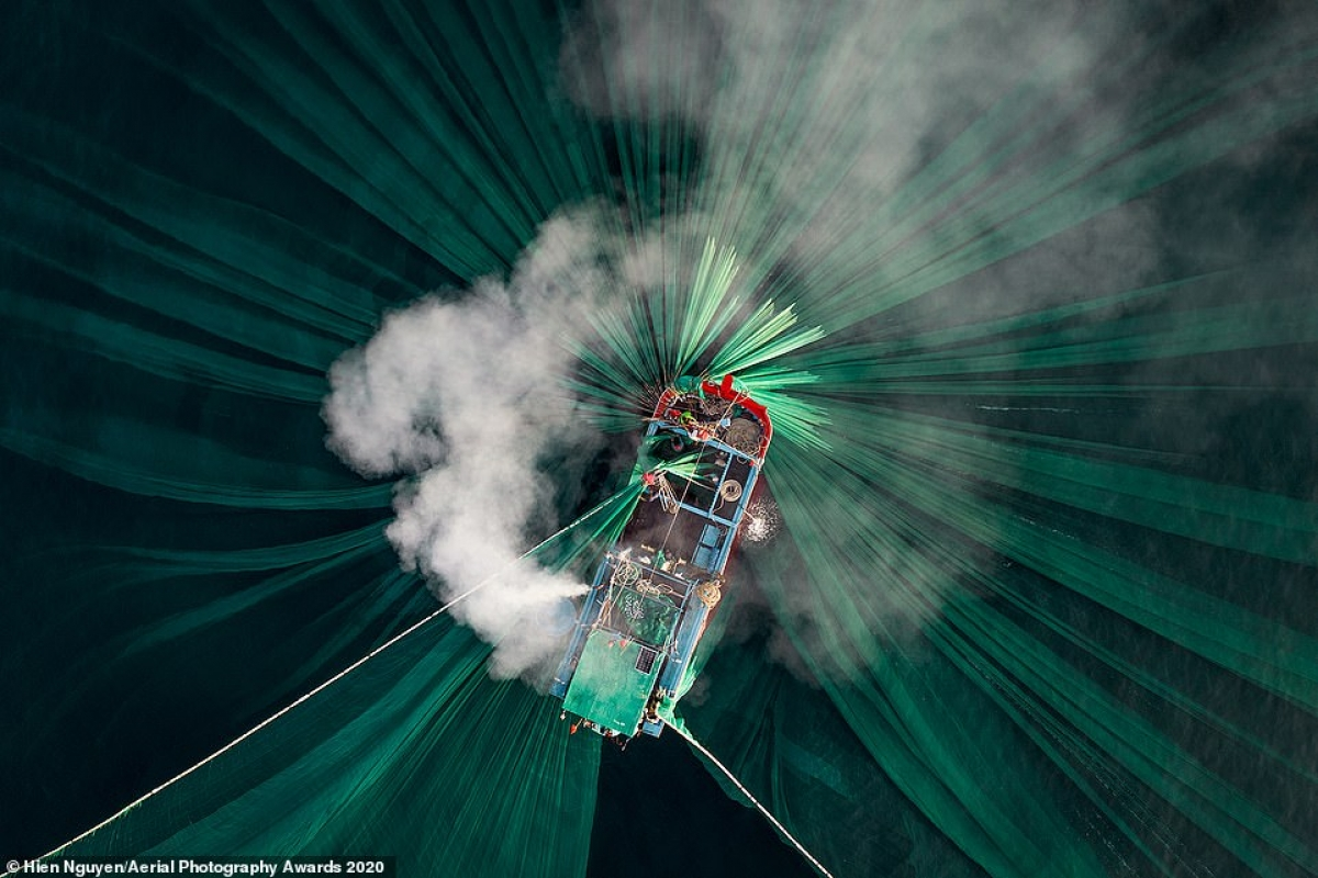 Organisers of the Aerial Photography Awards this year receive thousands of entries from 65 countries worldwide. Among the winning shots that most impressed viewers was a submission by Vietnamese photographer Hien Nguyen in the People category. The image depicts smoke pouring from the engine of a boat that belongs to anchovy fishermen working along the Phu Yen coastline, with their green nets illuminated under the water.