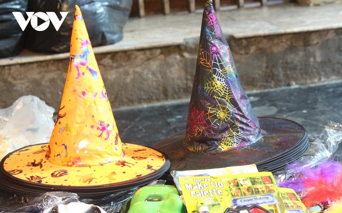 Colourful witch hats excite children viewing the festive items.