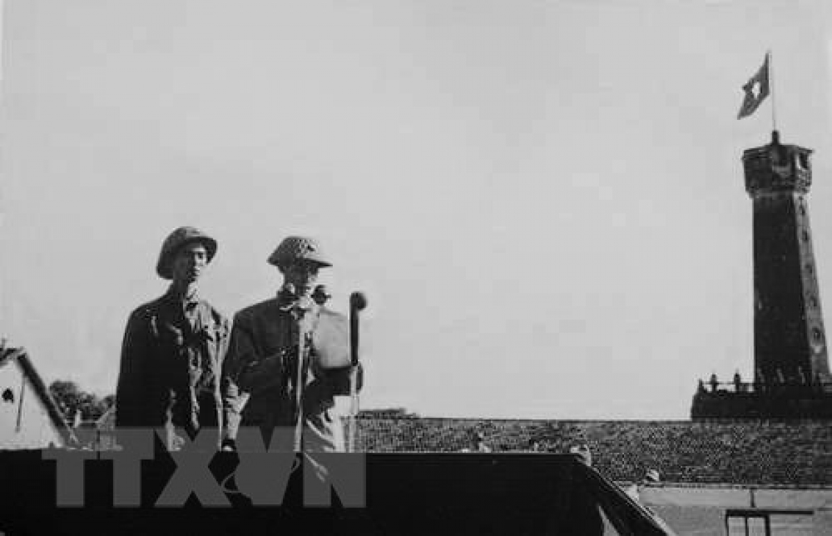 Major General Vuong Thua Vu is present on the podium during the first flag salute ceremony held to celebrate Hanoi's victory on October 10, 1954.