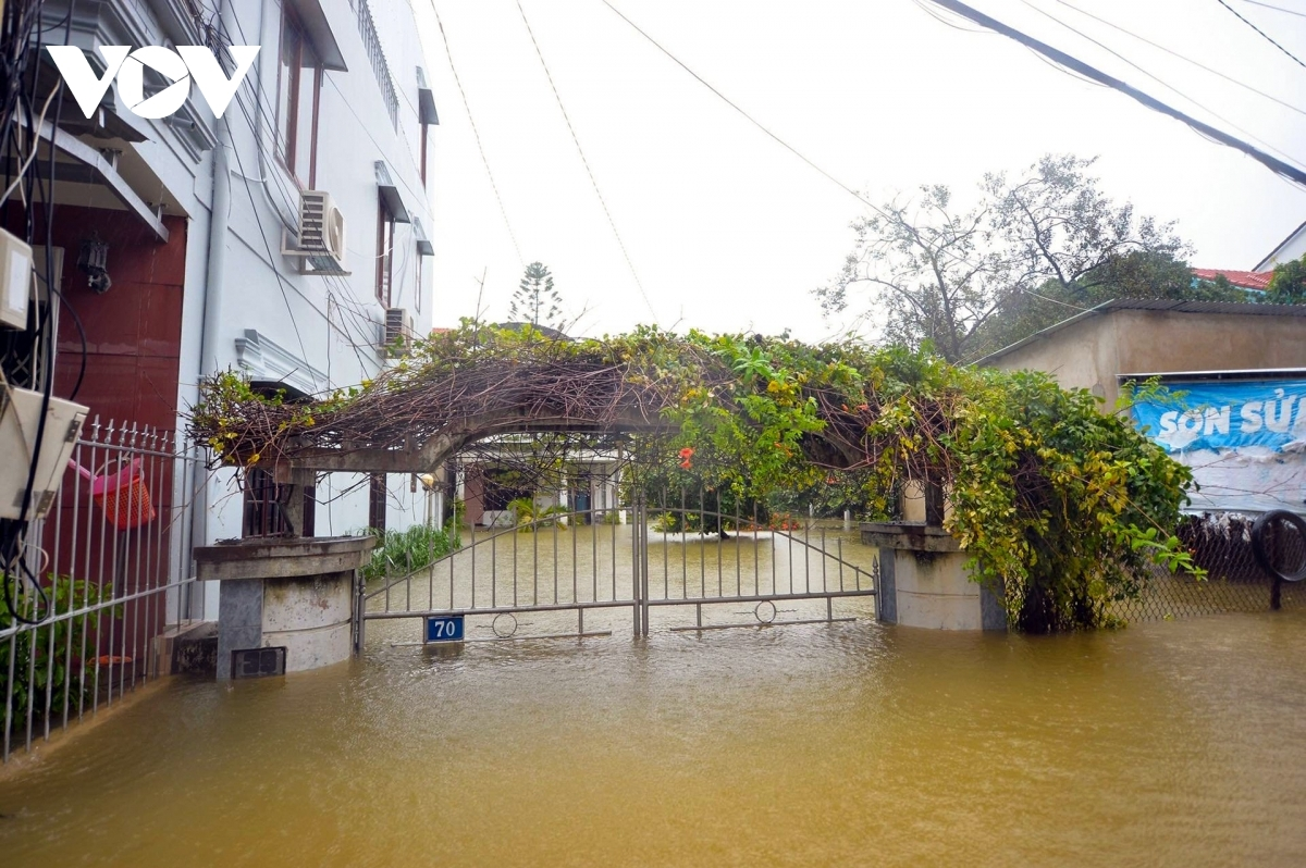 A gate to a house sits one metre deep in water.