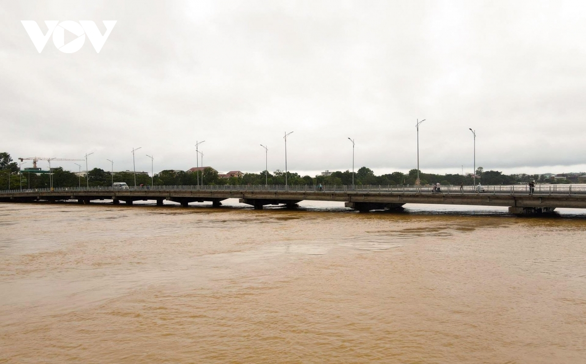 The scene as Phu Xuan bridge sits just above the water level
