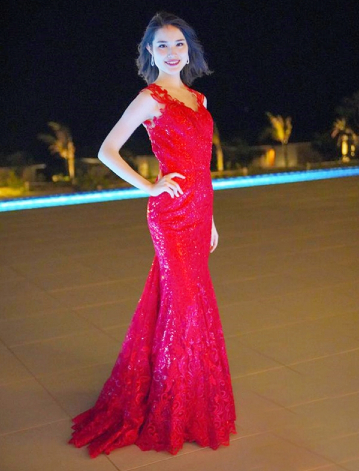 Japanese beauty Anna Tode, 20, shines whilst wearing a red evening gown.