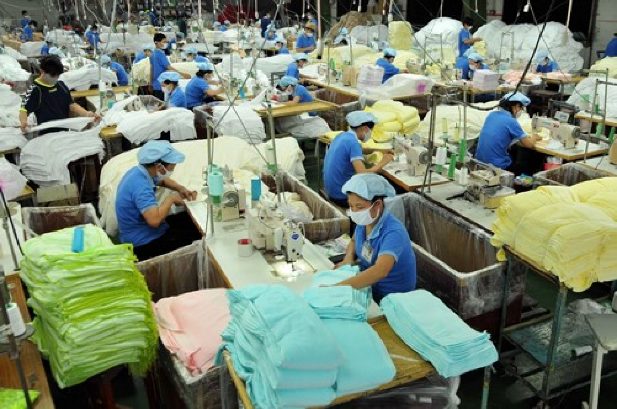 Workers at a textile factory in HCM City