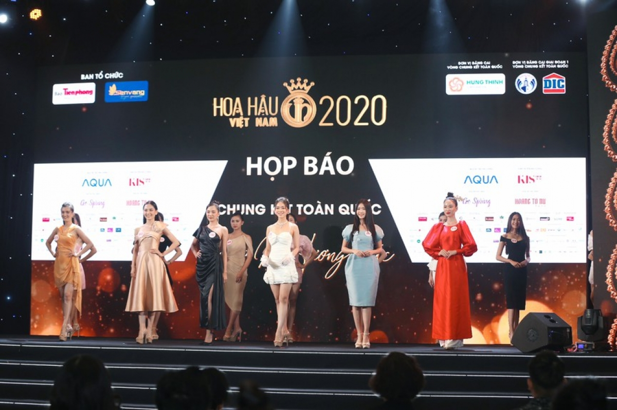 The 35 finalists to make the final stage of the contest model in cocktail dresses on stage.