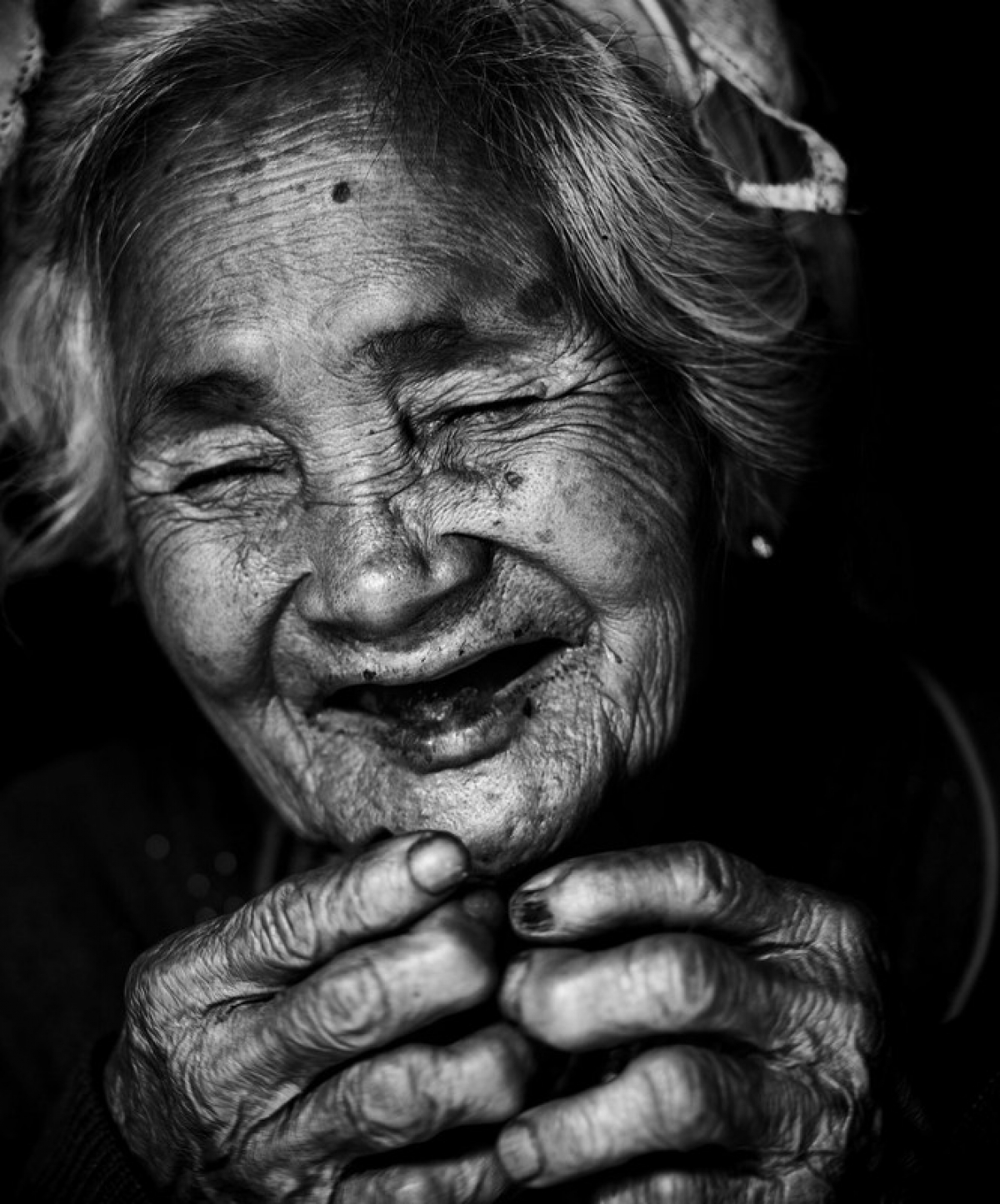 'Smile of Mom' by Vietnamese photographer @manhcuongvuong showcases an old person from the Raglai ethnic group in Khanh Hoa province as they cook.
