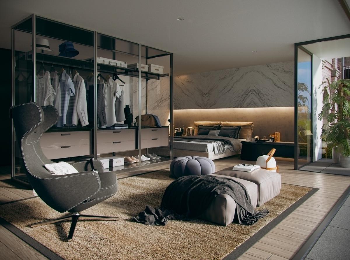 Đồ quần áo được phô bày trong tủ kính, đồng thời tạo ra một không gian tiếp khách giữa tủ quần áo và giường ngủ. Khá độc đáo nhưng vô cùng thú vị.