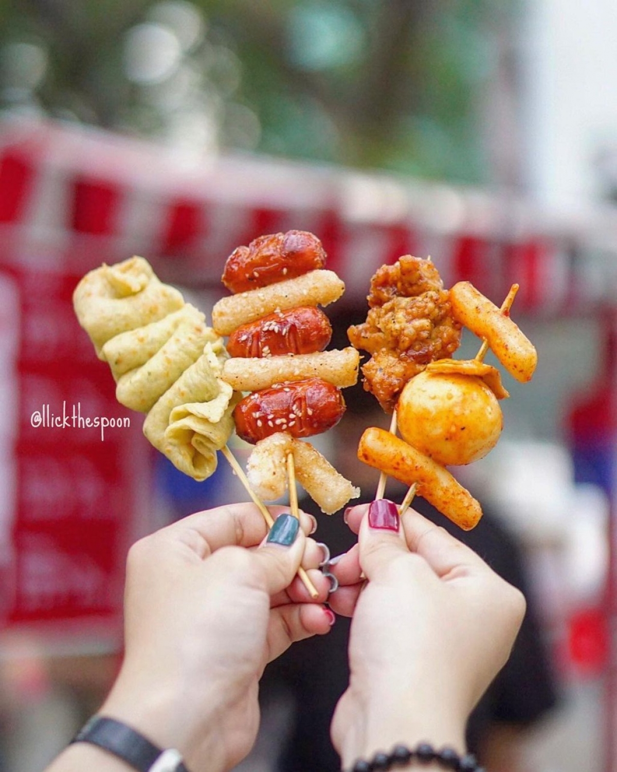 The menu includes delicacies such as tokbokki, roll vermicelli, fish balls, fried chicken balls, and sausages, with prices at around VND25,000, equivalent to US$1.08. (Photo: llickthespoon)