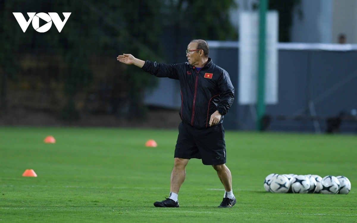 He continuously instructs the players on how to perform the correct movement.