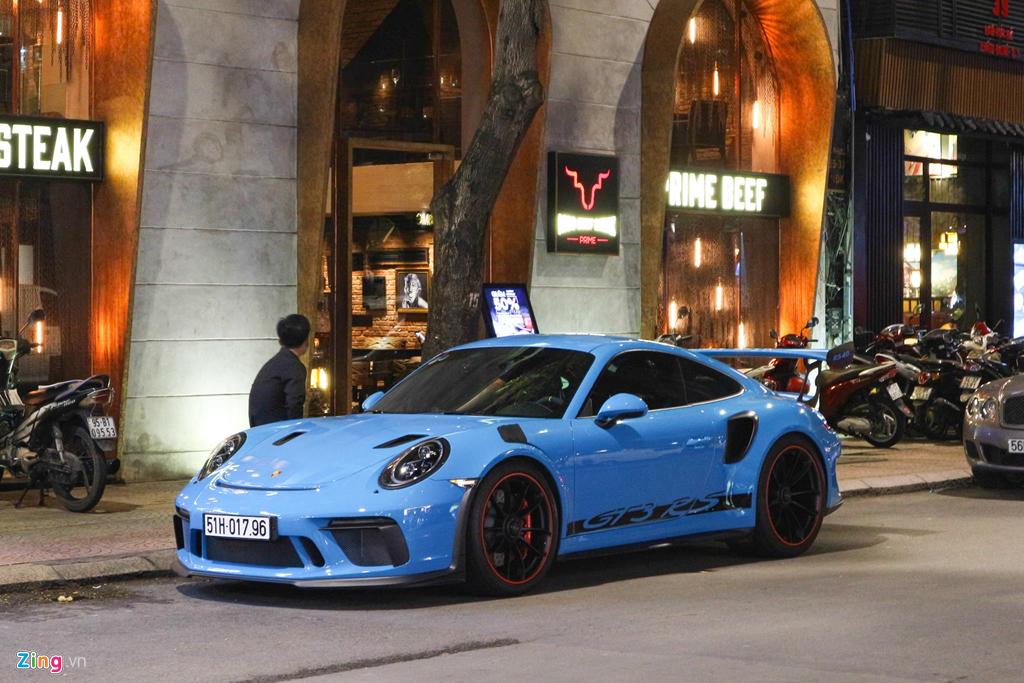 Sieu xe Porsche 911 GT3 RS mau xanh la doc nhat xuong pho Sai Gon hinh anh 7