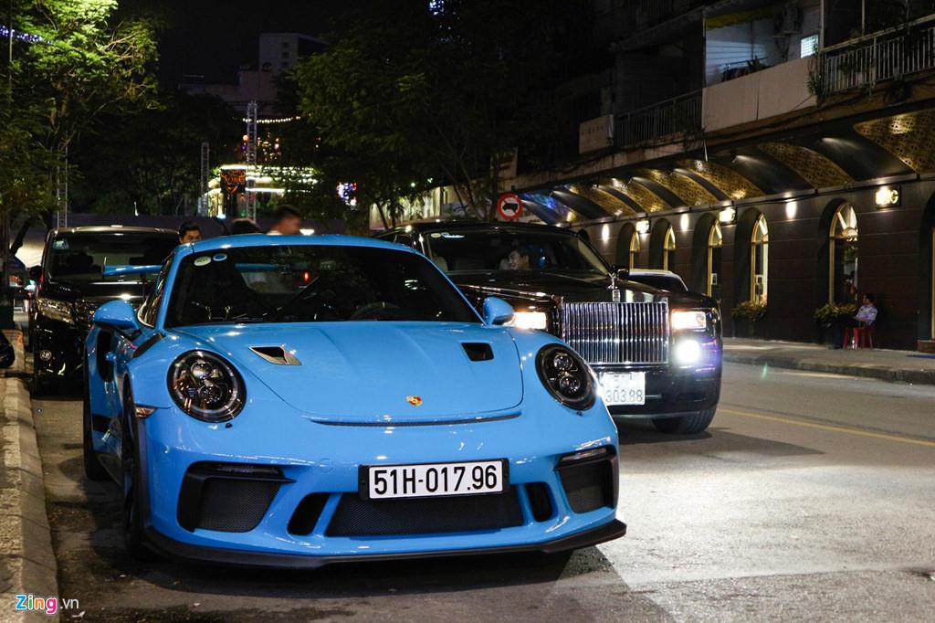 Sieu xe Porsche 911 GT3 RS mau xanh la doc nhat xuong pho Sai Gon hinh anh 6