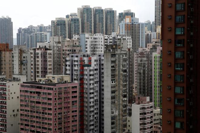 Gia nha qua dat, nguoi tre Hong Kong thue nha chung, chia cho o hinh anh 4