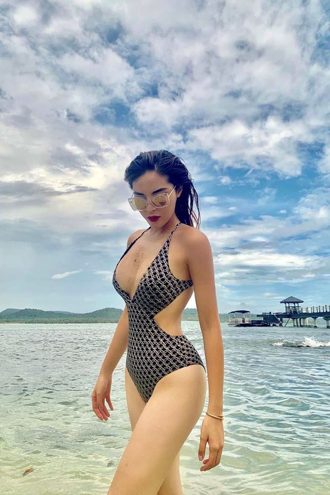 Hoa hau Ky Duyen da mac loai bikini nao de ton len vong mot cang day? hinh anh 8